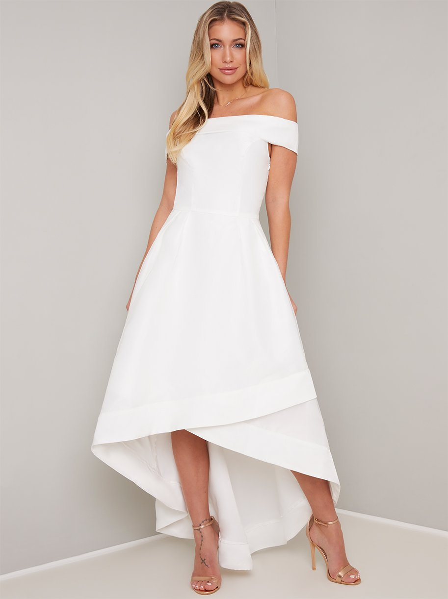 Image of high low wedding gown with bardot neckline, fitted waist and flared skirt