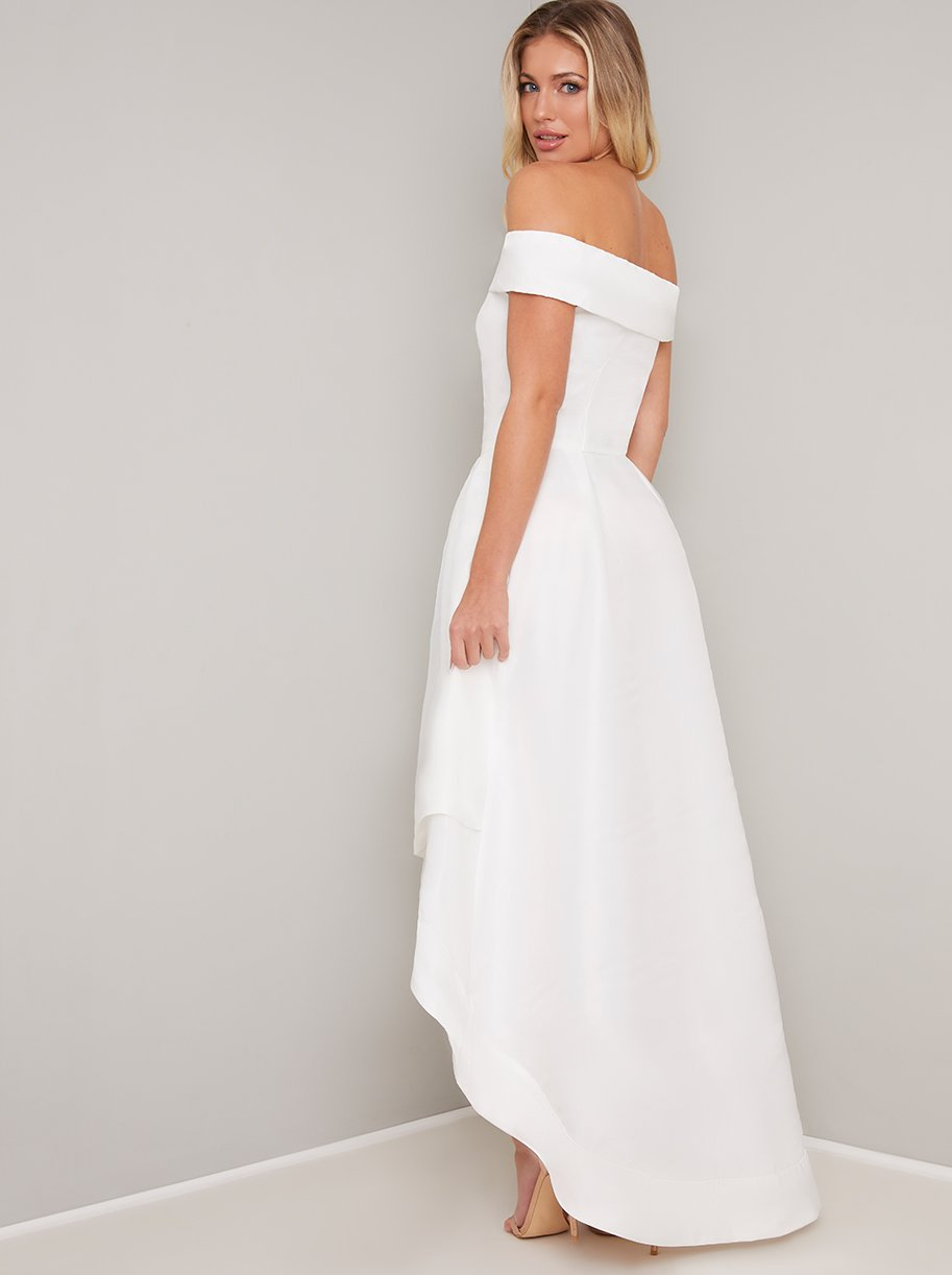Image of back of high low wedding gown with bardot neckline, fitted waist and flared skirt