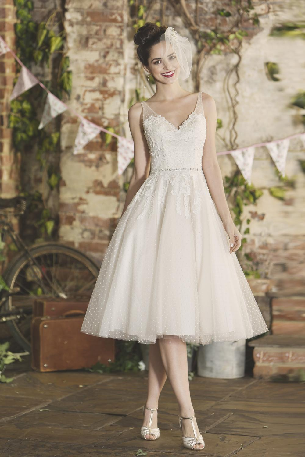 Sadie is a short tea length wedding dress with V neck