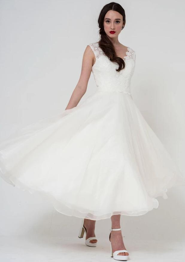Image of dainty floral lace bodice with floaty organza tea length skirt wedding gown by Freda Bennet