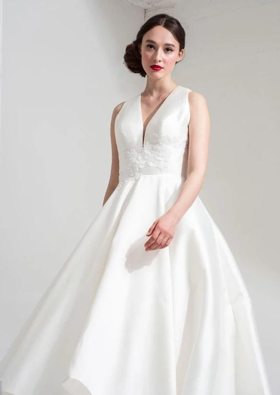 Close up of the Neve tea length bridal dress by Freda Bennet