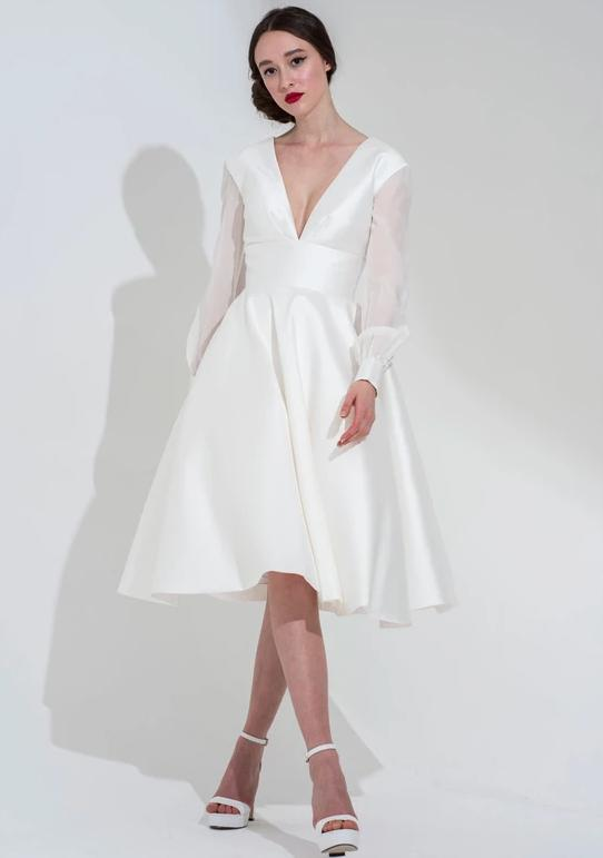 The Riley is a shorter tea length wedding dress by Freda Bennet