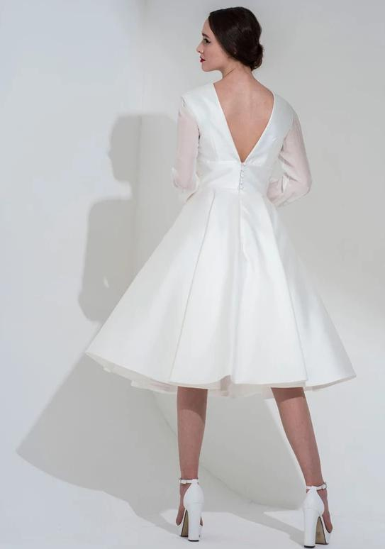 Back of the the Riley is a shorter tea length wedding dress by Freda Bennet