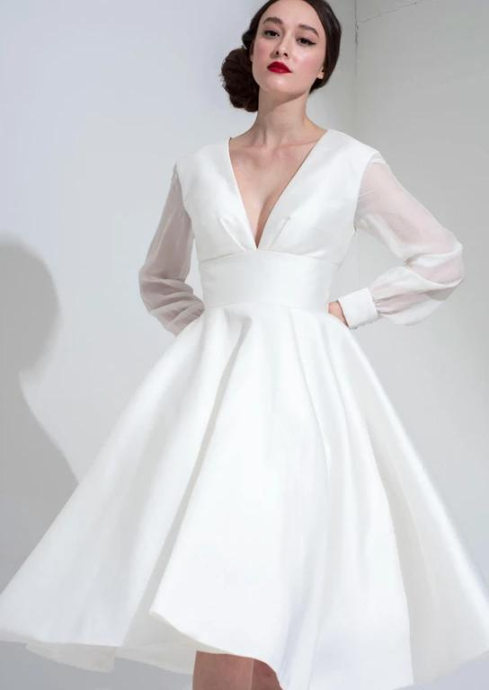 Close up of the Riley is a shorter tea length wedding dress by Freda Bennet