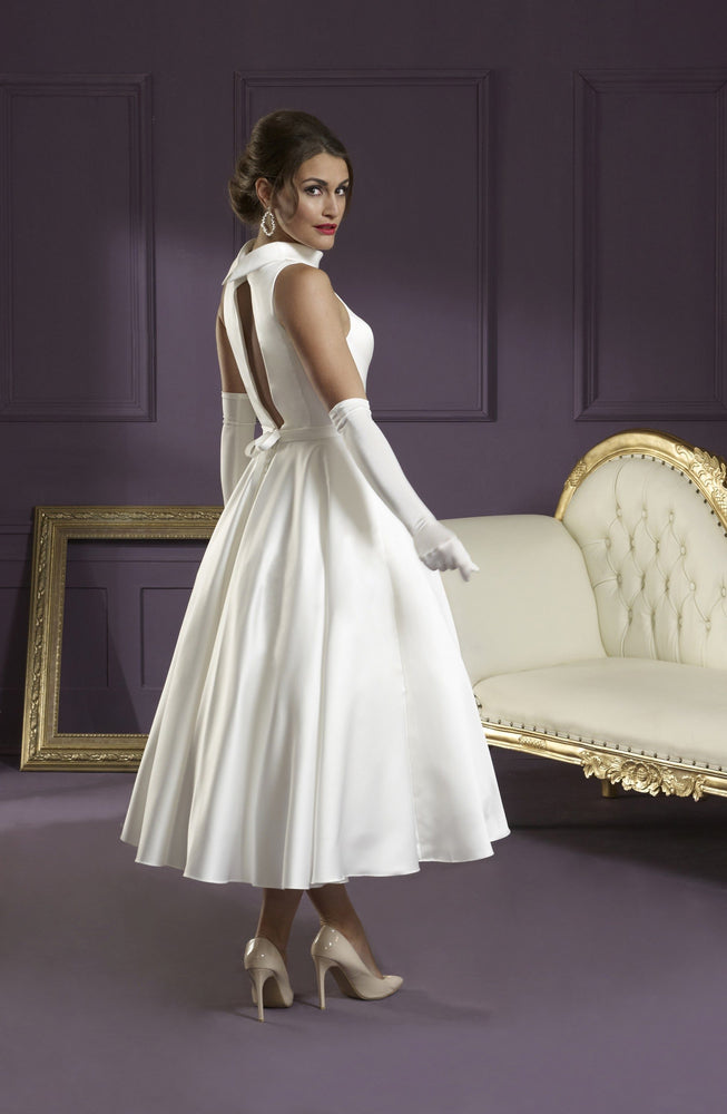 Back of Ivory satin tea length wedding gown with cut out back
