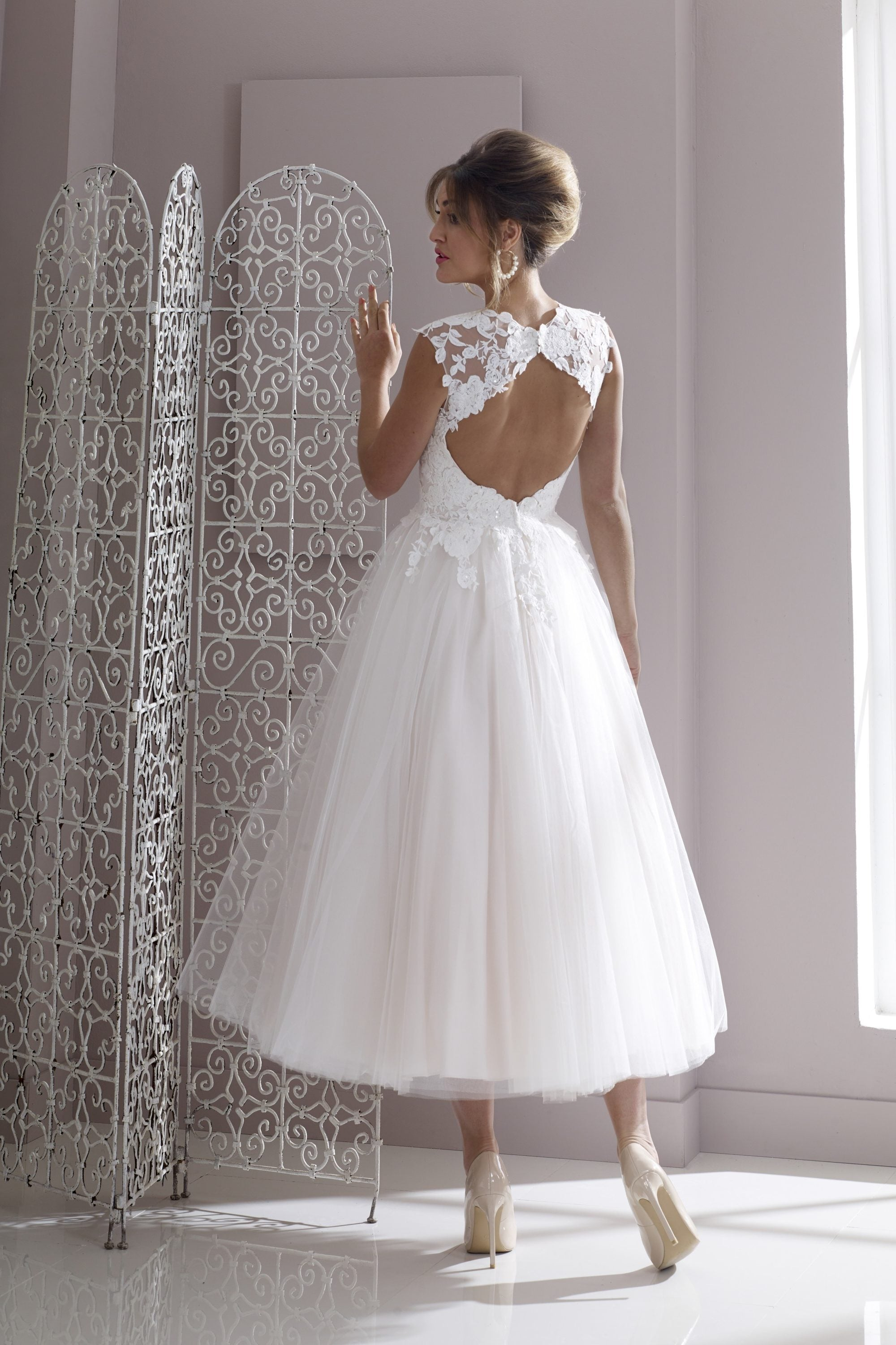 Back of lace and tulle tea length wedding gown