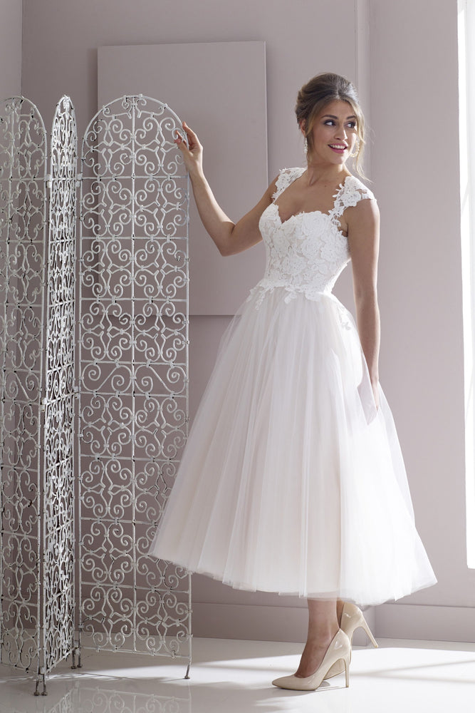Lace and tulle tea length bridal gown with cut out back detail