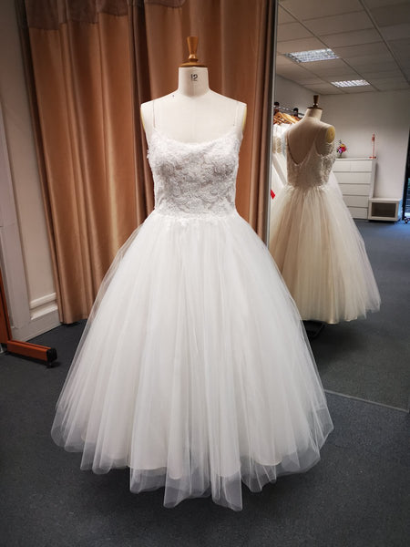Wedding dress with spaghetti strap lace bodice and super full tea length skirt