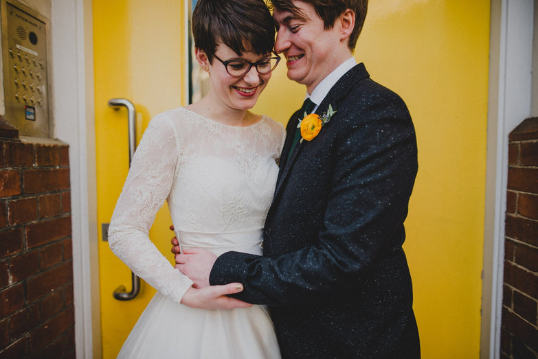 Loving couple Lottie and Alex with Lottie wearing her Blanche dress.