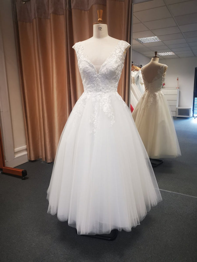 Lace bodice wedding dress featuring V back and full tea length tulle skirt.