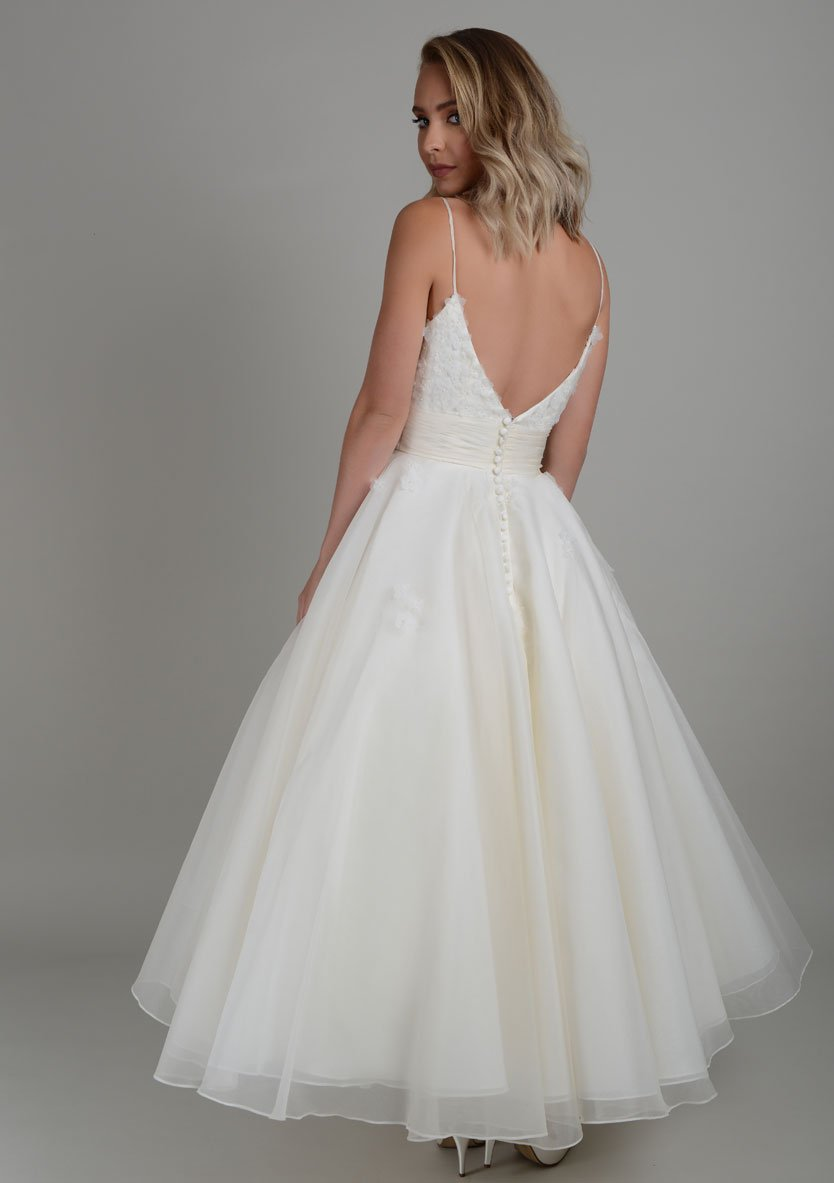 Back of silk organza strappy tea length wedding dress