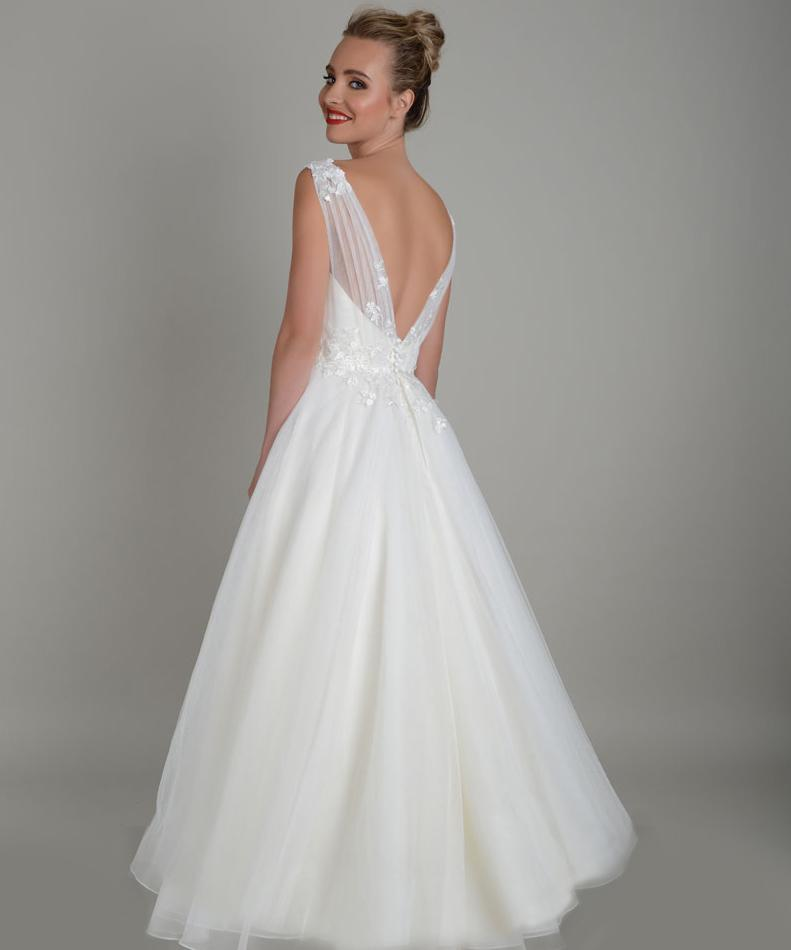Back image of tea length wedding gown in super soft tulle with delicate lace appliqué