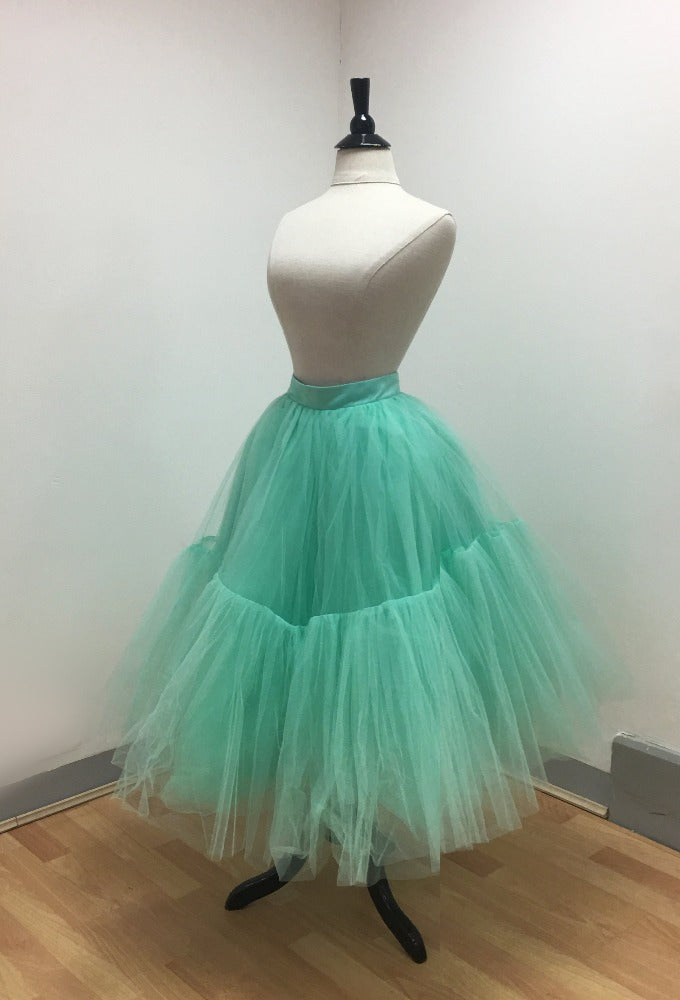 Image of lined tulle tiered skirt with fitted waistband and zip back closure in mint.