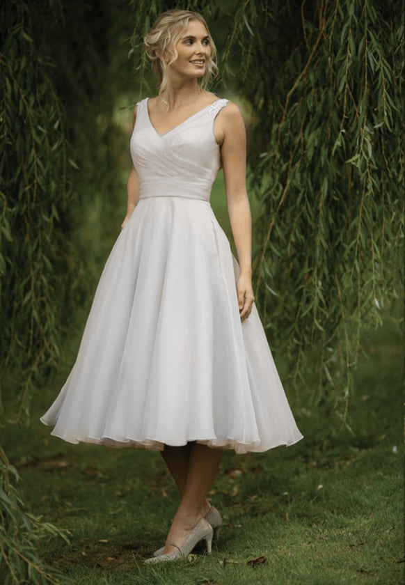 Vintage inspired  short 40's style wedding gown with fine appliqués to the shoulders, pleated fitted bodice and full fifties organza skirt