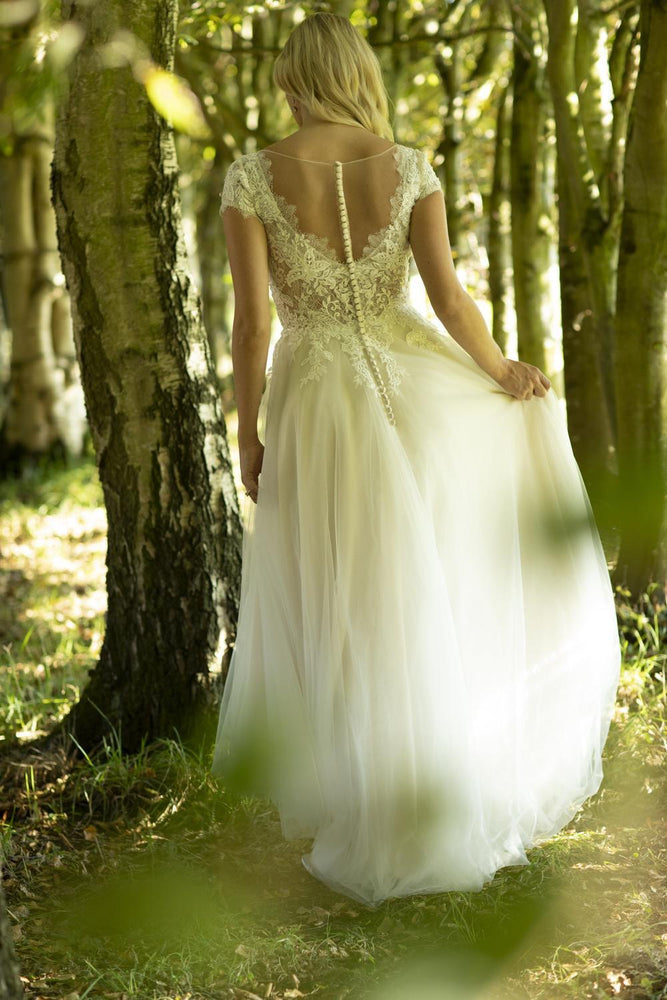 This is the back of Marisa; a chic vintage-inspired lace bridal dress