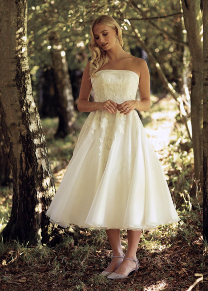 Front of calf length 50's inspired  strapless wedding gown