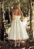 Back of calf length 50's inspired  strapless wedding gown