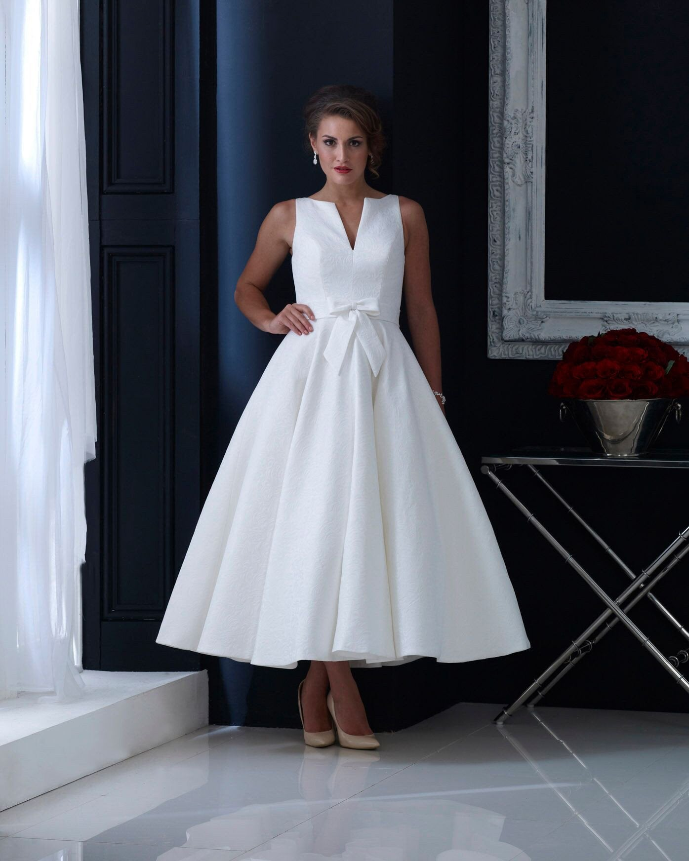hn-veronica Brocade tea length wedding dress with subtle bow and elegant cut