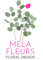 Floral arrangement with Mela Fleurs written underneath