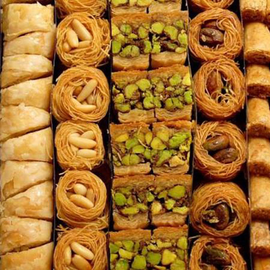 A variety of Middle Eastern Arabic Premium Assorted Baklava made from fine sheets or shredded phyllo dough, layered with handpicked quality ingredients, then baked using purified butter, and soaked in our special sugar syrup. Sugar-free baklava available