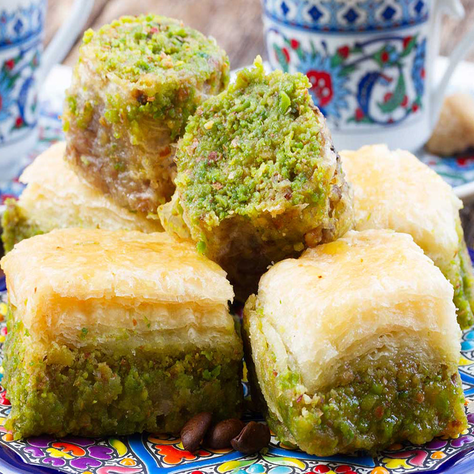 A rich mix of Middle Eastern Premium Baklava made from fine sheets or shredded phyllo dough, layered with carefully picked Pistachios, then using purified butter, baked and soaked in our special sugar syrup. Sugar-free baklava available.