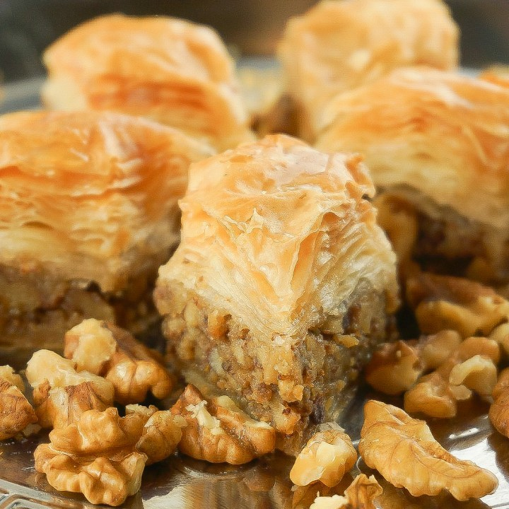 A rich mix of Middle Eastern Arabic Premium Baklava made from fine sheets or shredded phyllo dough, layered with carefully picked Walnuts, then baked using purified butter, and soaked in our special sugar syrup. Sugar-free baklava available.