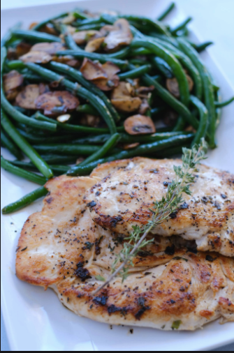 Garlic & Rosemary Pork Chop with Roasted Garlic Green Beans & Demi Glazed Mushrooms