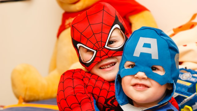 Why do children peform better when dressed as superheroes?
