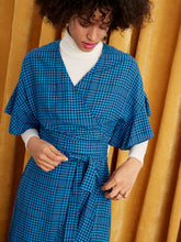 Load image into Gallery viewer, Kitri blue wrap dress available to rent - front view on model