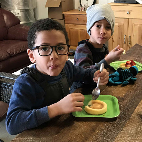 Two young boys enjoying a maple syrup treat
