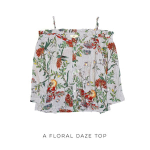A Floral Daze Top  This stunning floral print pinstripe top will leave you in the perfect floral daze! The perfect adjustable straps will maintain your comfort while showing off the stunning neckline and off-shoulder look. Pair with your favorite shorts or jeans for a truly versatile look to carry you through the seasons.