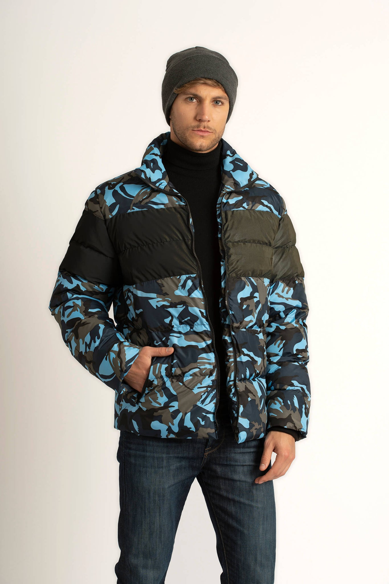 Man wearing a Tough Duck Black Eider Pintail Puffer in camo.