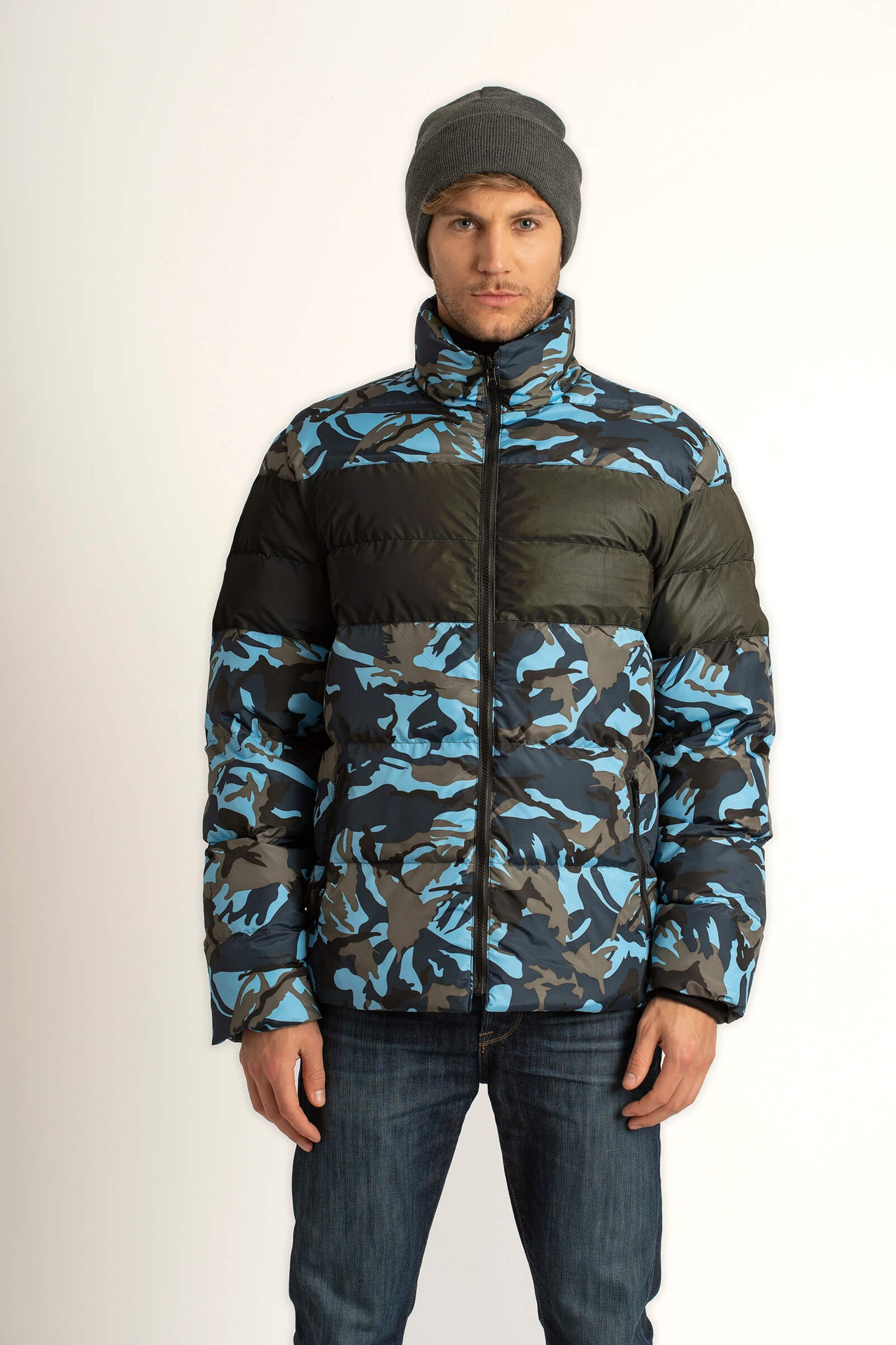 Man wearing a Tough Duck Black Eider Pintail Puffer in camo with zipper done up.