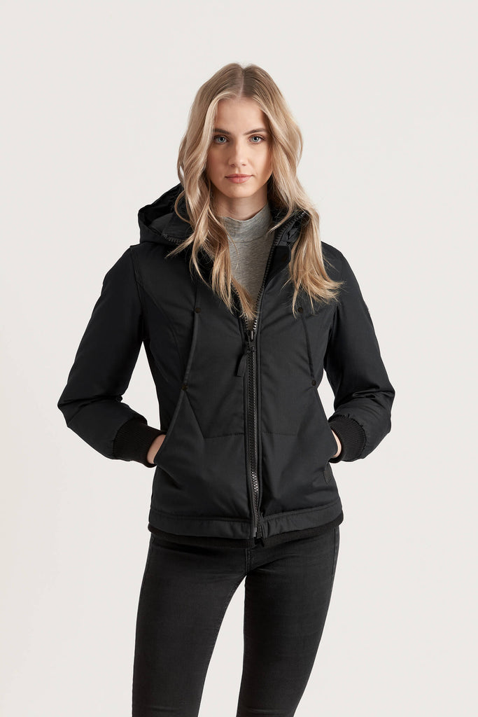Women wearing a Tough Duck Black Mallard Bomber in black with her hands in her pockets