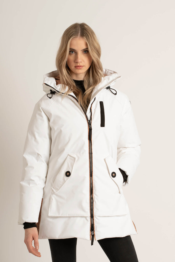 Women wearing a Tough Duck Black Widgeon Mid-Length Parka in white with one hand in her pocket.