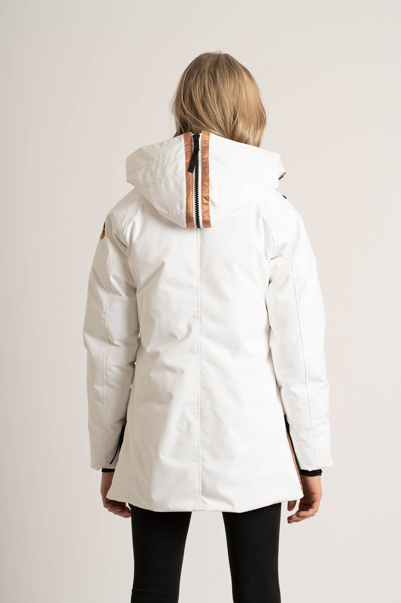 The back view of the Tough Duck Black Widgeon Mid-Length Parka in white.