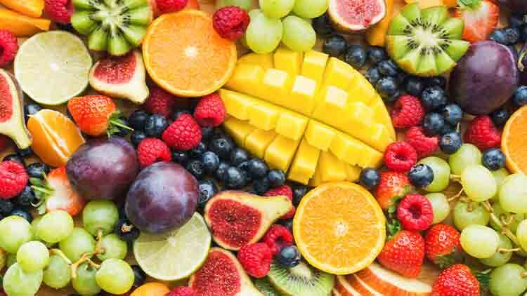 Assortment of healthy raw fruits and berries platter