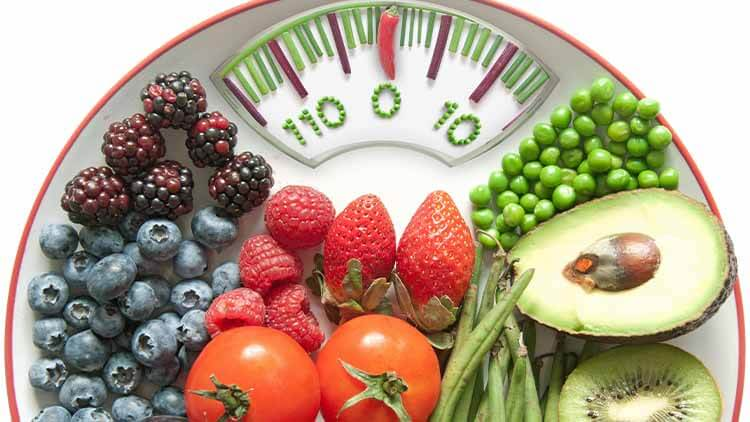 bathroom scales with veg and fruit on top of it
