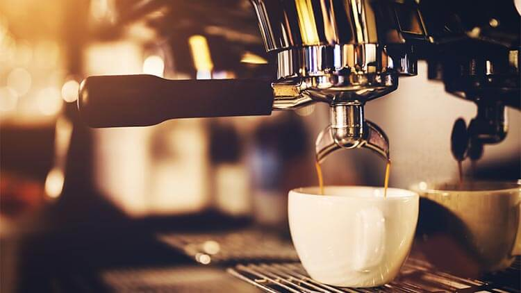Coffeemaker-pouring-coffee-into-a-cup