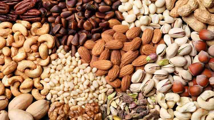 Organic mixed nuts as background,