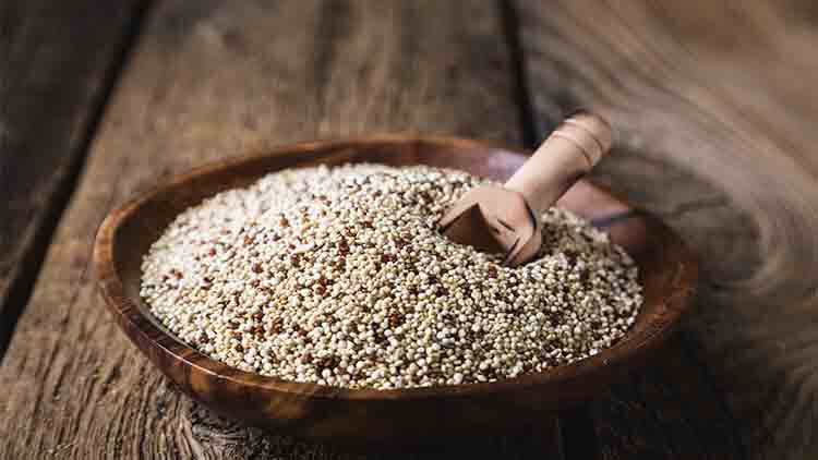 Quinoa seeds on a wooden table