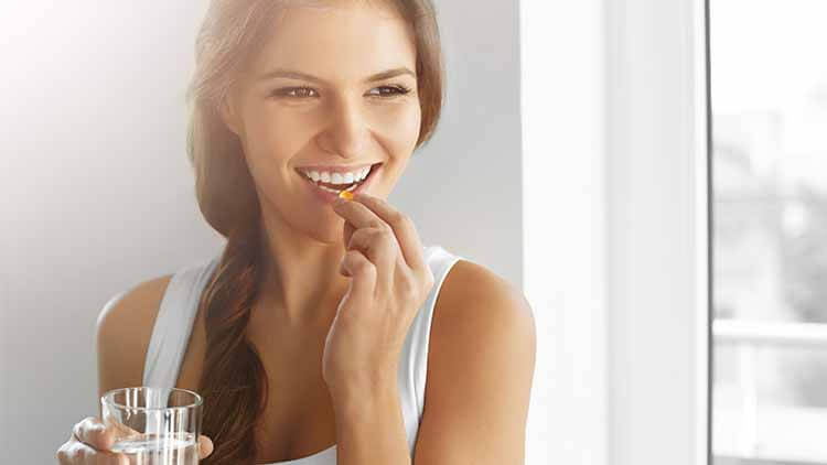 Woman With Fish Oil Capsules.