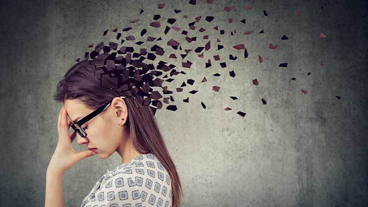 Young woman losing parts of head as symbol of decreased mind function.