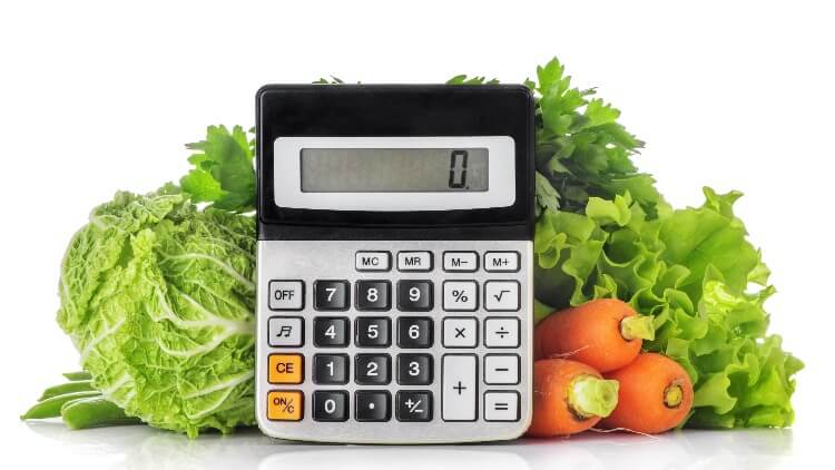 Calculator in front of vegetables
