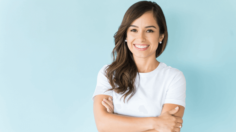 Happy self assured woman on isolated background