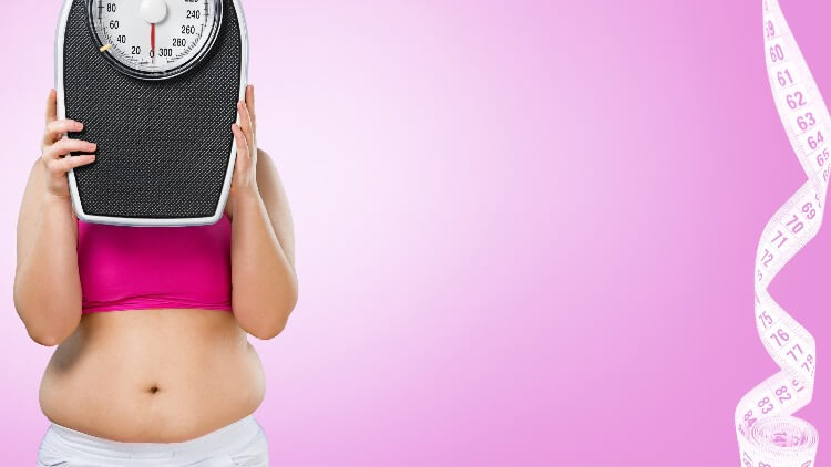 Overweight woman holding up scales over face