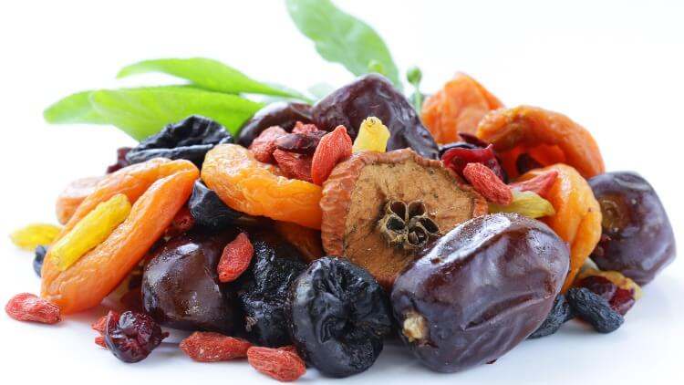 Pile of dried fruits on white background