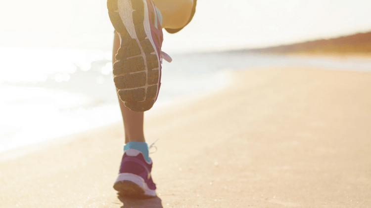 Exercise is also important for weight loss such as this woman running on the beach