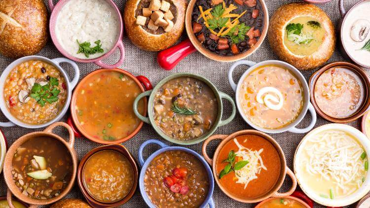 Variety of colourful soups in bowls