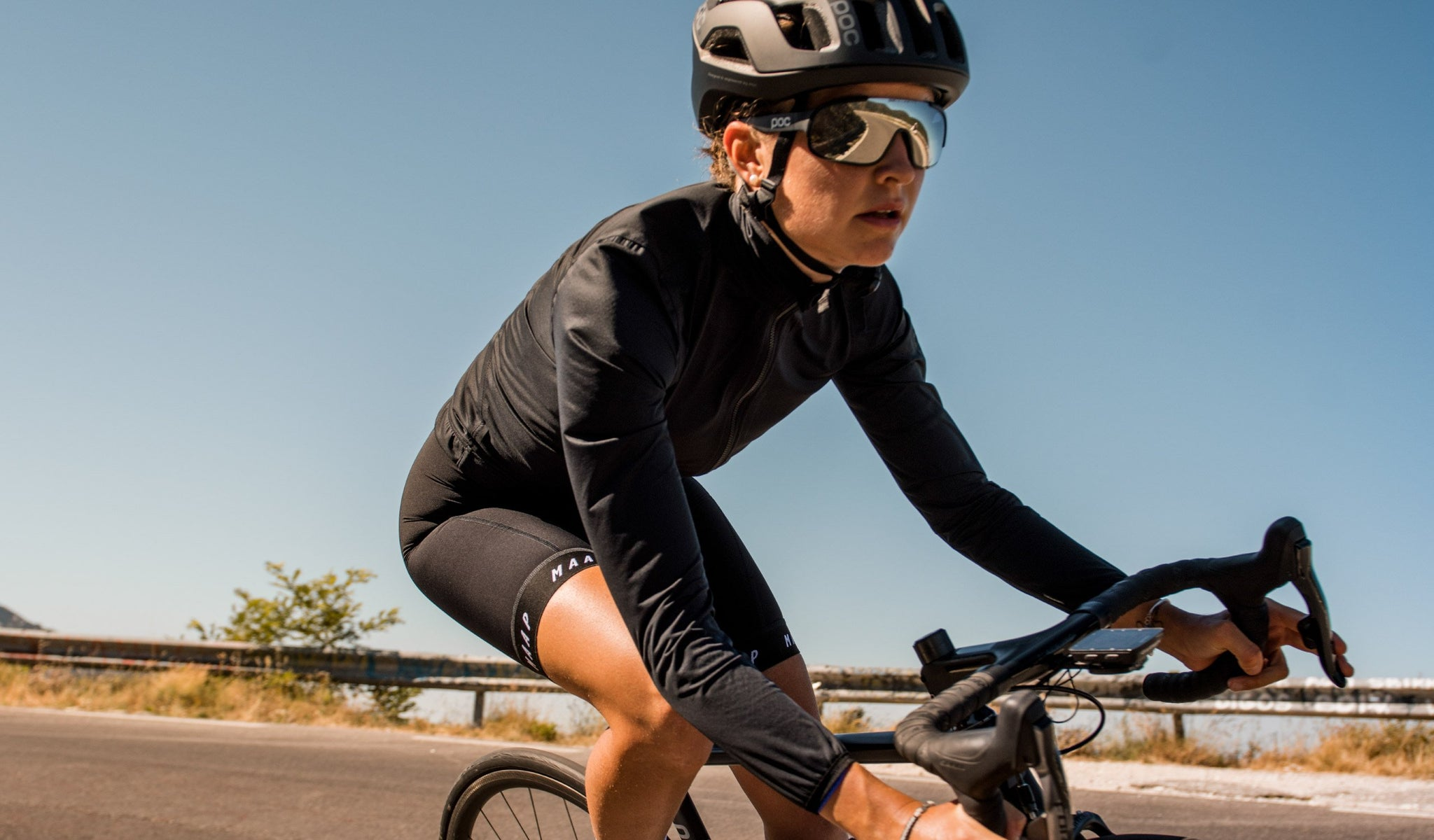 MAAP Women's Unite Team Cycling Rain Jacket in Black for riding in wet weather conditions.